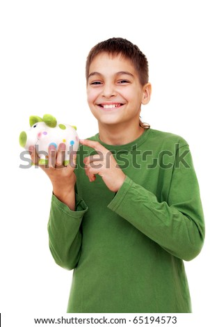 teenage boy smiling portrait points piggy money box isolated on white