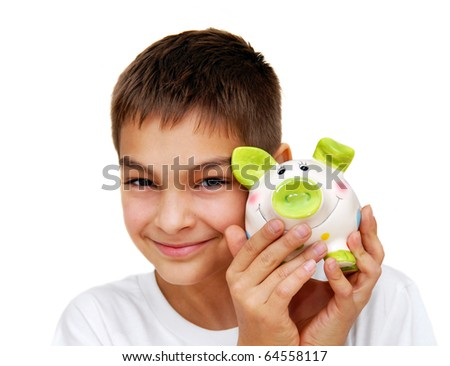 teenage boy smiling portrait with piggy money box isolated on white