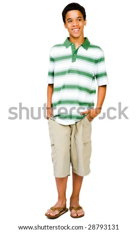 Teenage boy standing with his hands in his pockets isolated over white - stock photo