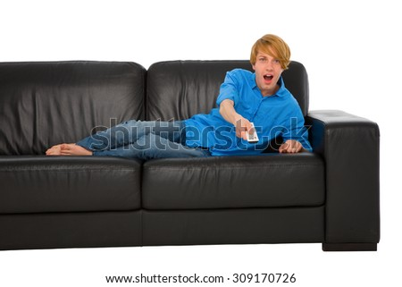 teenage boy watching tv - stock photo