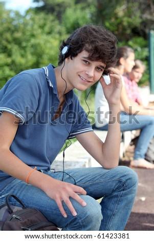 Teenage boy with headphones on - stock photo