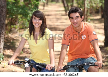 Teenage couple on bike ride - stock photo