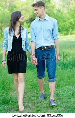 Teenage couple walking in a field