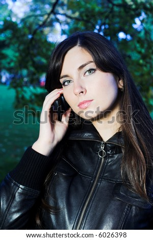 Teenage culture and lifestyle, talking to boyfriend or girlfriend and getting updated on the latest gossip. - stock photo
