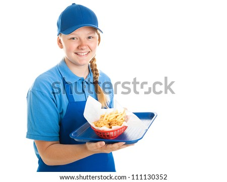 Teenage fast food worker holding a tray of chicken nuggets and fries.  Isolated on white. - stock photo