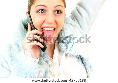 Teenage female speaking over the cellphone isolated on white - stock photo