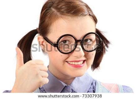 Teenage geeky girl raising thumbs-up to the camera - stock photo