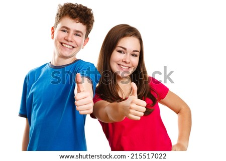 Teenage girl and boy showing OK sign isolated on white  - stock photo