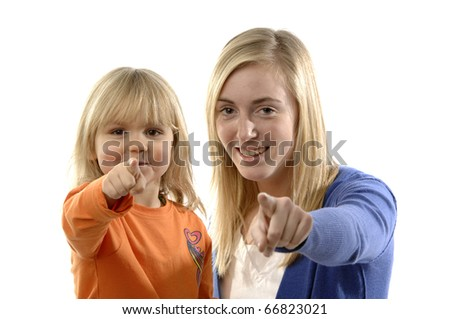 Teenage girl and toddler point their finger. - stock photo