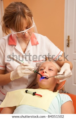 Teenage girl at the dentist. - stock photo
