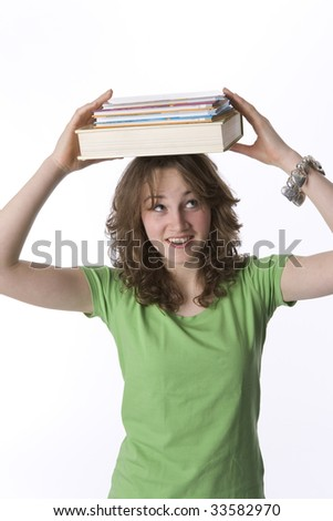 Teenage girl carrying books on her head