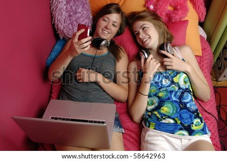 Teenage girl checks her text messages on her mobile phone. - stock photo