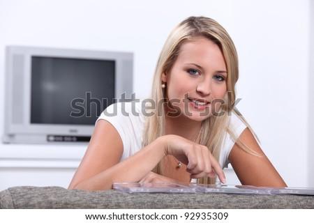 Teenage girl choosing CD - stock photo