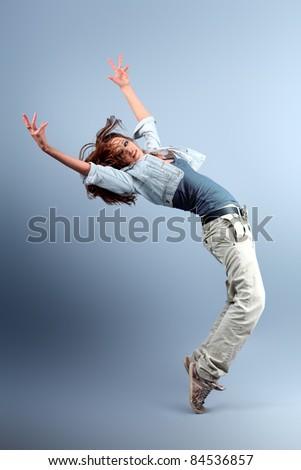 Teenage girl dancing hip-hop at studio. - stock photo