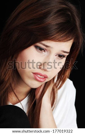Teenage girl depression - lost love - isolated on black background  - stock photo