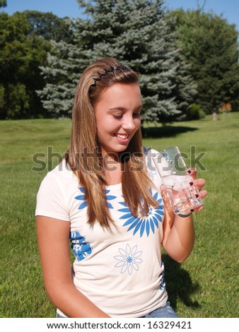 teenage girl drinking a glass of water