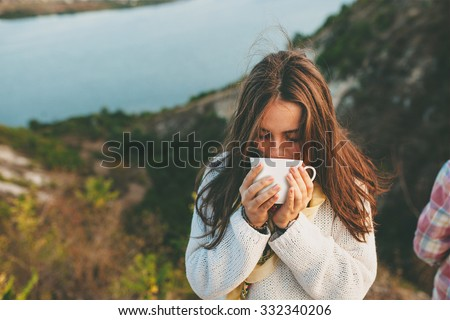 Teenage girl drinking coffee. Beautiful young woman in casual wear with cup of hot coffee. - stock photo