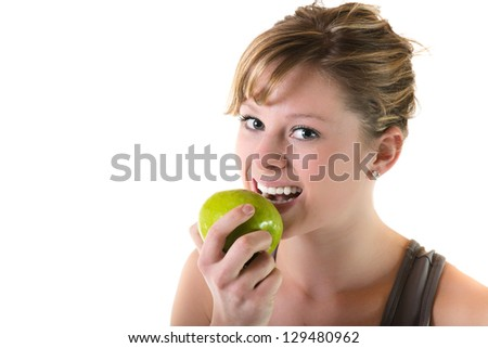 Teenage girl eating an apple. Isolated on white background - stock photo