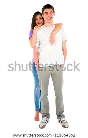 teenage girl embracing teenage boy - stock photo