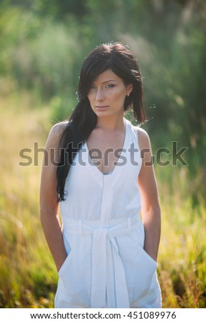 Teenage girl enjoy with sunshine in wheat field - stock photo