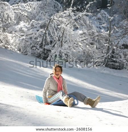 Teenage girl enjoying her sled ride - stock photo