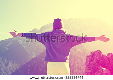 Teenage girl feel freedom in mountains scenery. Vintage instagram picture. - stock photo