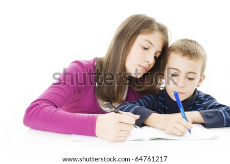 Teenage girl helping her brother with his homework - stock photo