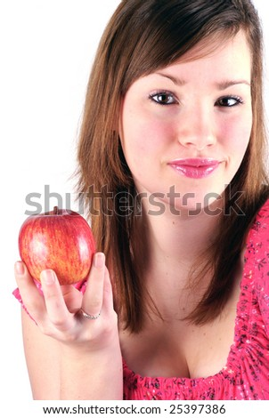 Teenage girl holding an apple on a white background.
