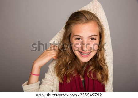teenage girl holding arm behind head - stock photo