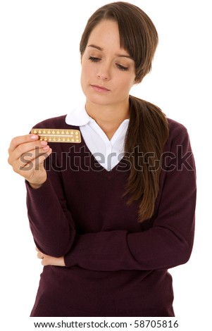 Teenage girl holding contraception pills isolated on white - stock photo