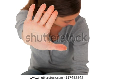 teenage girl  holding hand up to block violence - stock photo