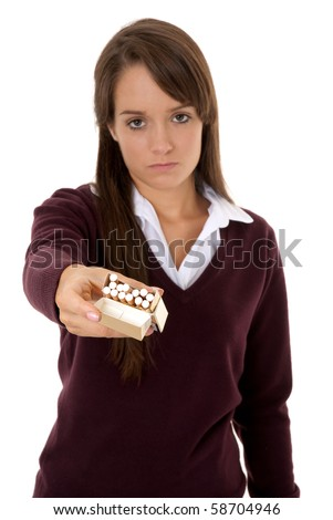 Teenage girl holding out packet of cigarettes isolated on white