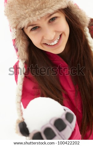 Teenage Girl Holding Snowball Wearing Fur Hat
