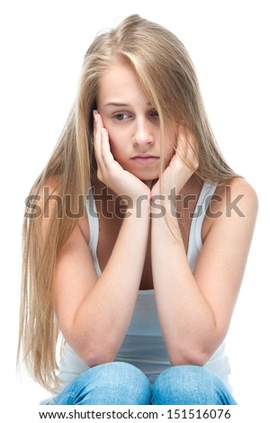 Teenage girl in a depressed state. Isolated on white - stock photo