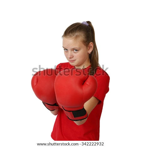 Teenage girl in boxing gloves with harsh facial expression isolated on white background - focus on face