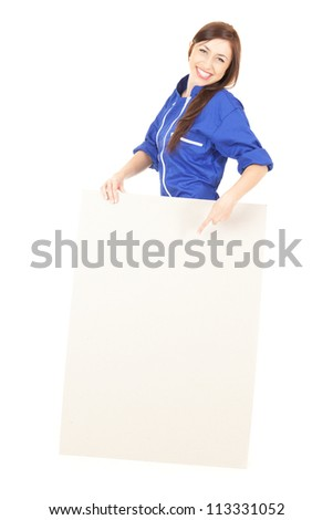 teenage girl in coveralls with empty board, white background - stock photo