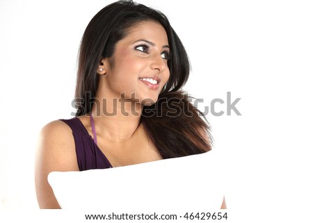 Teenage girl in jolly mood with pillow