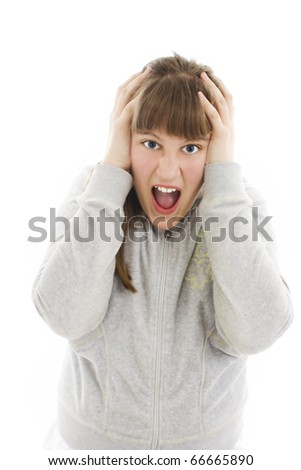 Teenage girl is screaming out loud and pulling her hair - stock photo