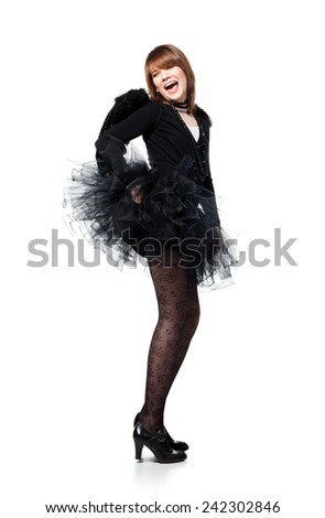 Teenage girl is wearing costume of black angel during masquerade party, isolated on white background. - stock photo