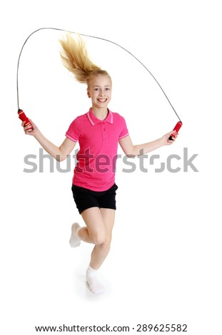 Teenage girl jumping rope - isolated on white background