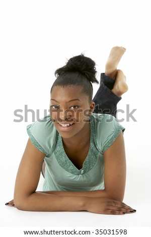Teenage Girl Laying On Stomach - stock photo