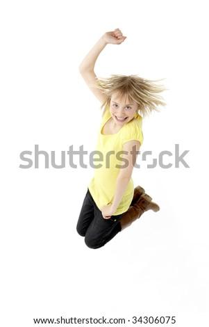 Teenage Girl Leaping In Studio - stock photo
