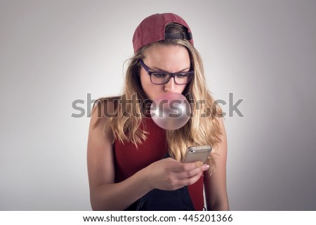 Teenage girl looking at her cellphone  - stock photo