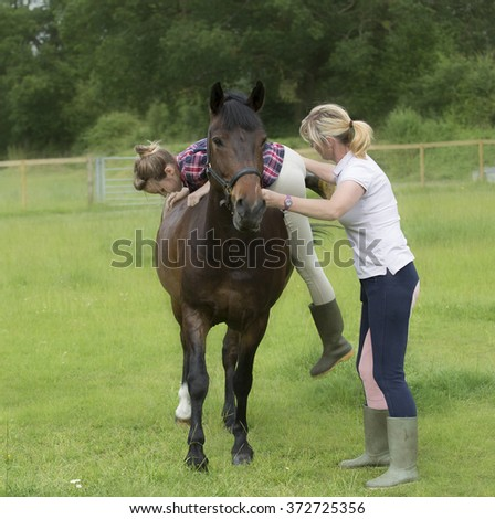 Teenage girl mounting her pet pony for a riding bareback lesson