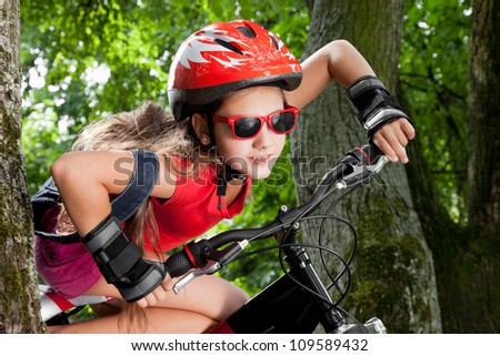 teenage girl on a bicycle in park - stock photo