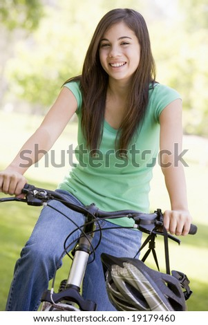 Teenage Girl On A Bike