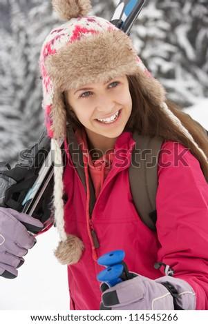 Teenage Girl On Ski Holiday In Mountains - stock photo