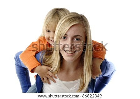 Teenage girl piggybacks a toddler - stock photo