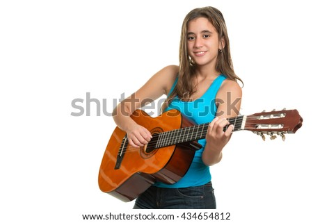 Teenage girl playing an acoustic guitar - Isolated on a white background - stock photo