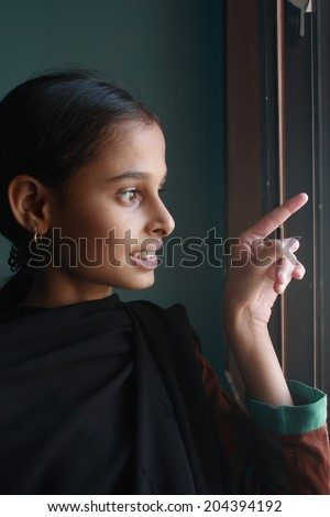 Teenage girl pointing finger - stock photo